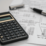 tax paperwork and calculator